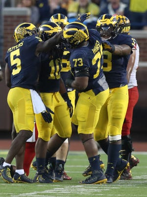 Michigan Wolverines defenders celebrate a stop against the Maryland Terrapins in the second half Saturday, Nov. 5, 2016 at Michigan Stadium.