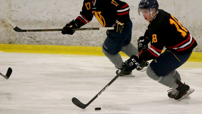 Ruslan Abyanov (18) and Mattias Wikstrom (17) of the West Sound Warriors skate in a game last season against the Seattle Totems. The club announced this week that it will not field a team during the 2018-19 season.