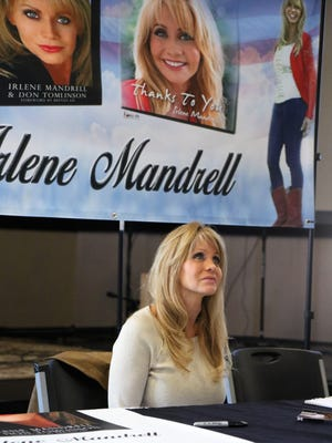 Irlene Mandrell listens during her book signing Friday at TCA in Jackson.