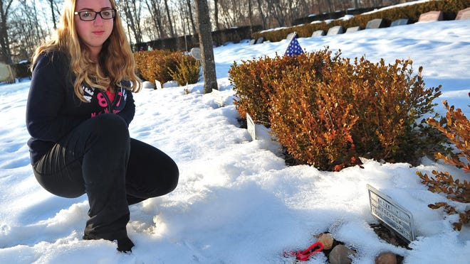 Hannah Rhoads, 14, a freshman at South Plainfield High School, visited the family plot of her friend and classmate, Alize Jefferson, who was one of five killed in the Clinton Avenue fire a few years ago. Rhoads was shocked to see only tin markers at the family plot, so she started a fund drive and raised enough to put gravestones on each of the five graves.