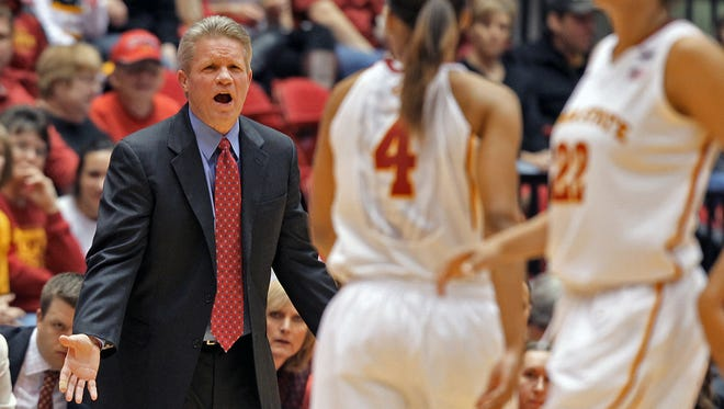 Iowa State head coach Bill Fennelly looked onto the court with players #4 Nikki Moody and #22 Brynn Williamson, right, in first half play against Iowa during women's basketball game at Hilton Coliseum in Ames on Thursday night Dec. 12, 2013.       Bill Neibergall/The Register