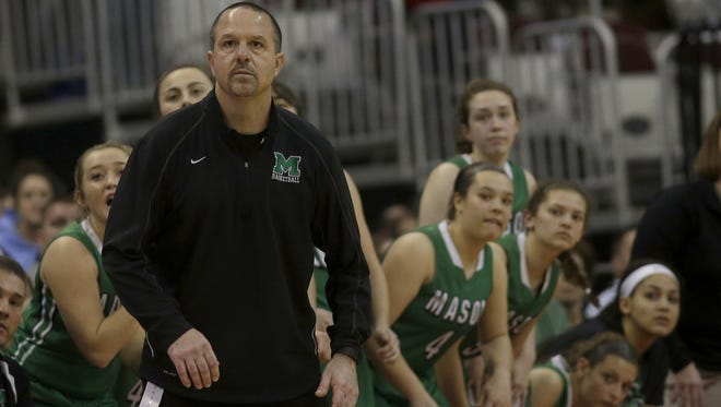 Mason head coach Rob  Matula and the bench look on during the Comets' Division 1 championship game against Wadsworth, Saturday, March, 12, 2016.