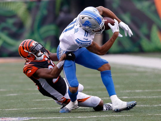 Lions wide receiver Marvin Jones (11) is brought down by Bengals cornerback William Jackson (22) during the second half of the Lions' 26-17 loss on Sunday, Dec. 24, 2017, in Cincinnati.