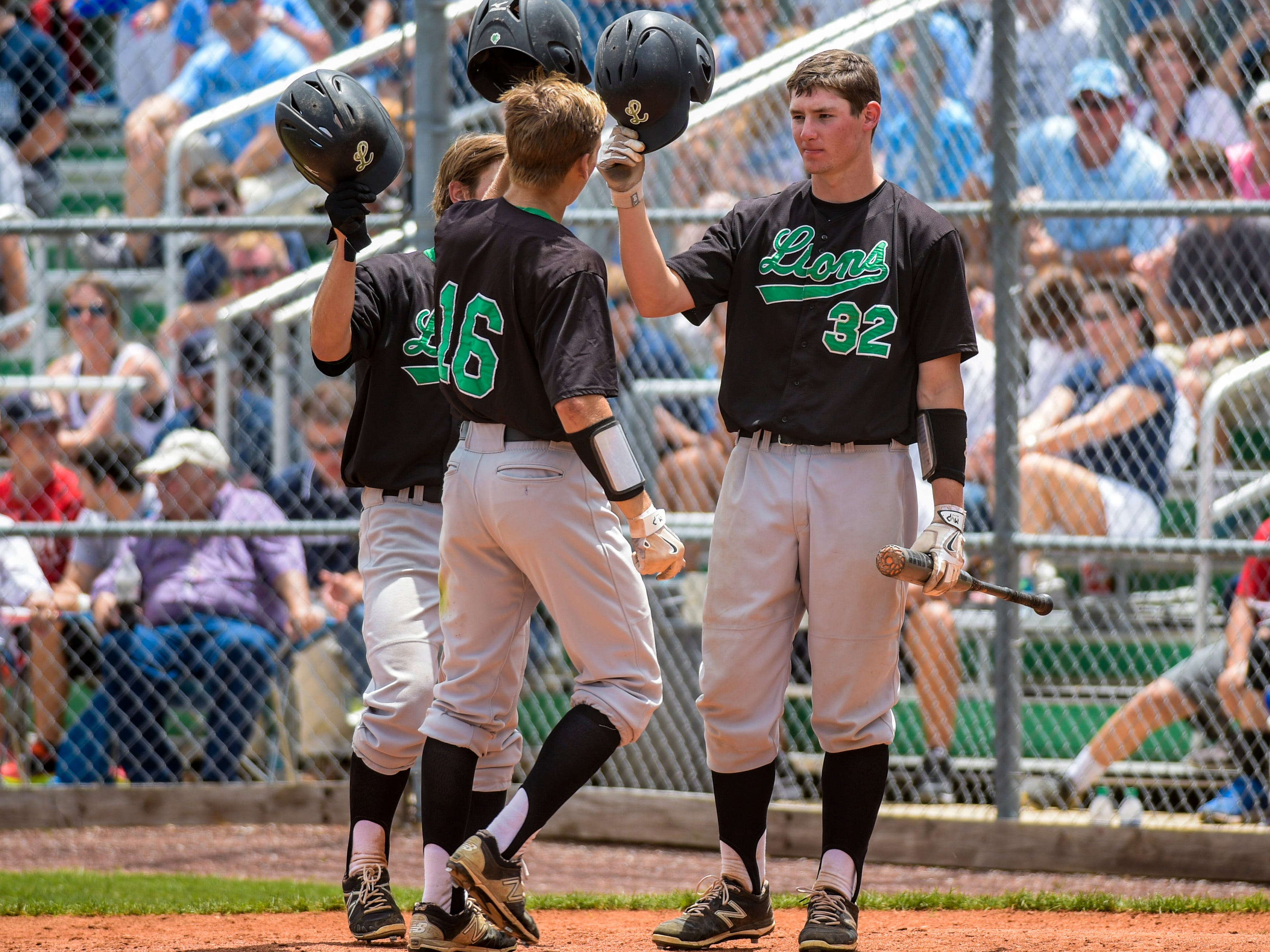 Lafayette High outfielder Antoine Duplantis (16) celebrates a two-run home run with teammates during Saturday's thrilling doubleheader against Barbe.