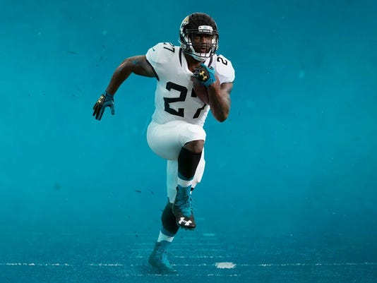 super popular e8f50 b45ed Jacksonville Jaguars' new uniforms ditch two-tone helmet