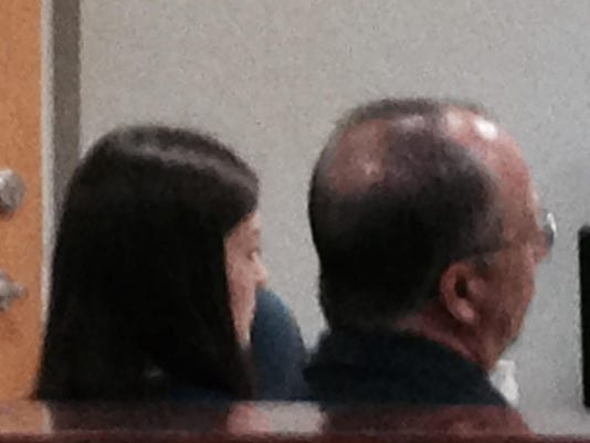 Rebecca Gotay sits next to defense attorney Keith Szachacz waiting for Monday's hearing to start. By John Torres