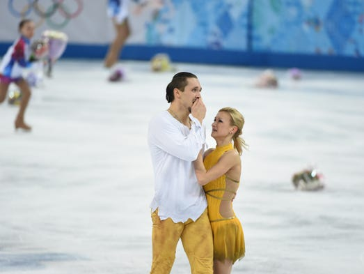 Tatiana Volosozhar and Maxim Trankov of Russia react after their pairs free skate program. Volosozhar and Trankov won the gold medal in front of their home crowd.