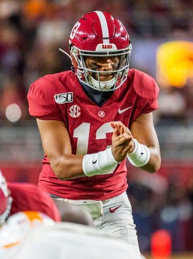 Alabama quarterback Tua Tagovailoa (13) sets the offense during the first half of an NCAA college football game against Tennessee, Saturday, Oct. 19, 2019, in Tuscaloosa, Ala. (AP Photo/Vasha Hunt)