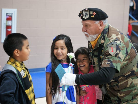 Children greeted the late Henry Morales of the Vietnam Veterans of America Chapter 358 color guard of Silver City after the Veterans Day observance at Ruben S. Torres Elementary School in 2018.