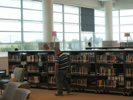 Patrons examine stacks at Deming High School's library.