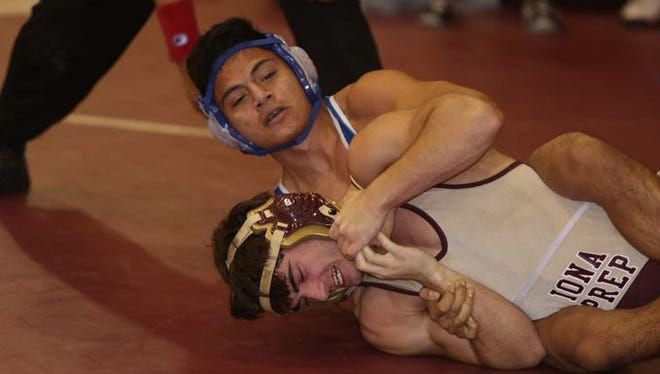 Wrestling action during the annual Carlucci Dual Meet at Purchase College Dec. 20, 2014.