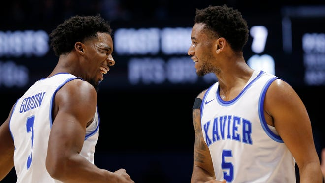 Xavier Musketeers guard Quentin Goodin (3) and guard Trevon Bluiett (5) celebrate after Bluiett's three-pointer in the second half of the NCAA Big East Conference basketball game between the Xavier Musketeers and the Creighton Bluejays at the Cintas Center in Cincinnati on Saturday, Jan. 13, 2018. Xavier took a 92-70 win in conference play over Creighton.