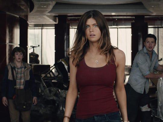 "Art Parkinson, Alexandra Daddario and Hugo Johnstone-Burt appear in a scene from ""San Andreas."""