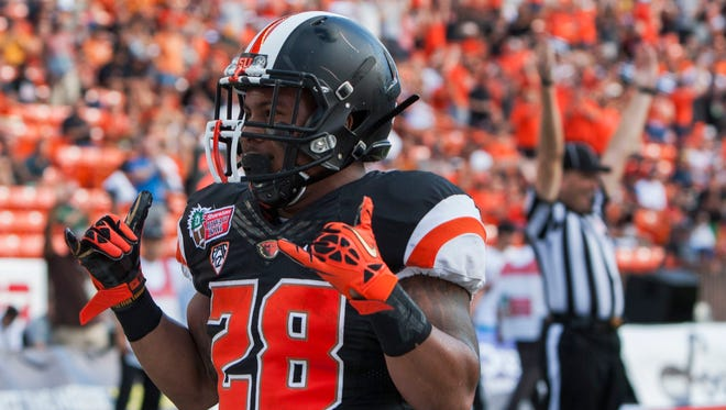 Oregon State Beavers running back Terron Ward (28) reacts after scoring a second quarter touchdown against the Boise State Broncos at the 2013 Hawaii Bowl at Aloha Stadium.