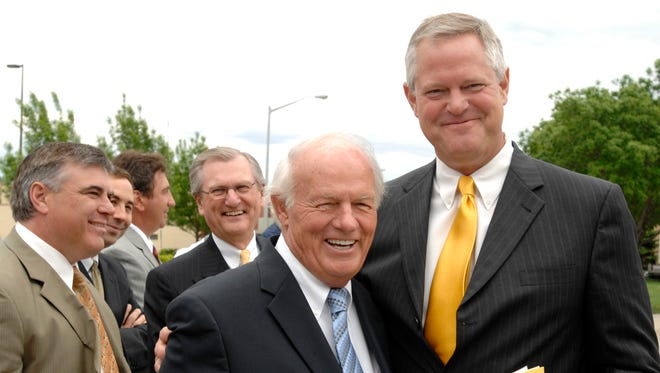 T. Denny Sanford and Kelby Krabbenhoft pose before the unveiling of a statue to honor the benefactor in 2008.