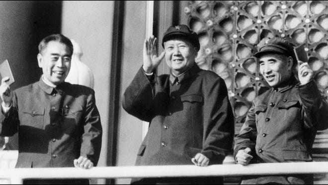 A photo taken on October 3, 1967 shows Chinese Chairman Mao Zedong. He is flanked by Prime Minister Zhu Enlai, left, and Defense Minister Lin Piao.