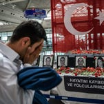 An airport employee mourns for his collegues killed at Ataturk airport international in Istanbul on June 30, 2016.