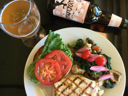 A recent lunch at the Riverview Terrace Cafe at the Frank Lloyd Wright Visitor Center near Spring Green, Wisconsin, included a chicken breast sandwich with wilted radish greens, candied radishes and a bottle of Livacious farmhouse ale from Next Door Brewing Co. of Madison.