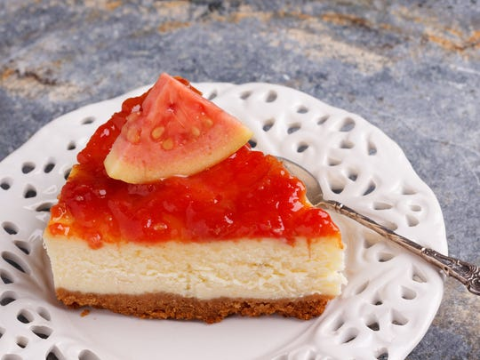 Cheesecake topped with guava jam.