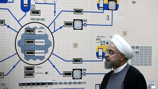 Iranian President Hassan Rouhani visits the Bushehr nuclear power plant just outside the port city of Bushehr in southern Iran on Jan. 13, 2015.