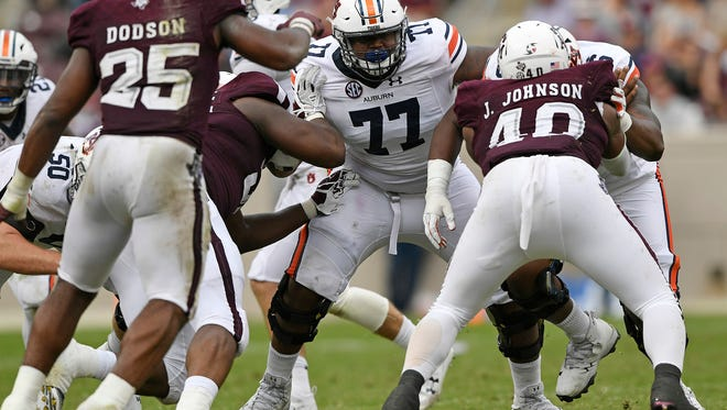 Auburn offensive lineman Marquel Harrell (77) and Auburn offensive lineman Prince Tega Wanogho (76).Auburn at Texas A&M on Saturday, Nov. 4, 2017 in College Station, TX.Todd Van Emst/AU Athletics