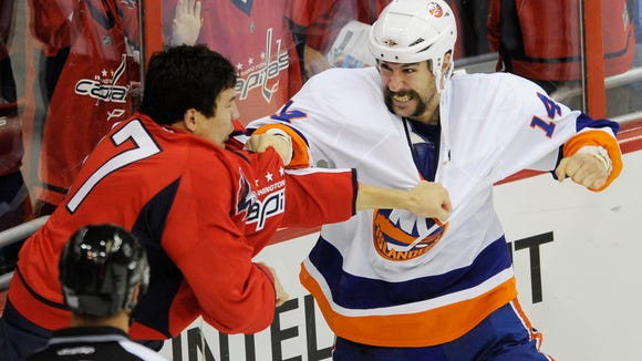 Trevor Gillies fighting D.J. King of the Washington Capitals, four seasons ago.