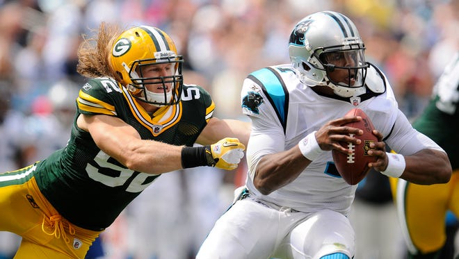 Packers linebacker Clay Matthews (52) tries to sack Panthers quarterback Cam Newton (1) in the second quarter during their 2011 game.