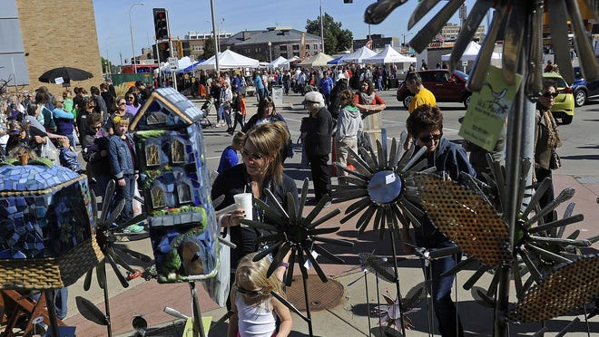 Lilli Fischenich, 4, shops at the Quirky Bird booth with her mom, Sarah, and grandma, Mary Kay, during the Sidewalk Arts Festival Saturday in Sioux Falls.