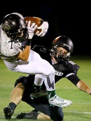 West Salem wide receiver Nate Okada is tackled by Sprague linebacker Dane McKinney during a Greater Valley Conference game, Friday, Oct. 2, 2015, in Salem, Ore.