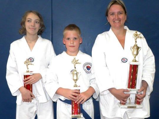 Julianna Ayres, Gavin Murray, Jan Miller each earned trophies at a recent testing for Stevens Taekwondo Academy.