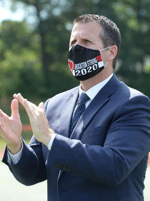 FILE - Mayor Robert Sullivan wears a face mask during the coronavirus pandemic as Brockton High School held its 154th graduation exercises at Marciano Stadium, Saturday, July 25, 2020.