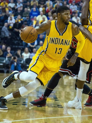 Indiana Pacers forward Paul George (13) dribbles the