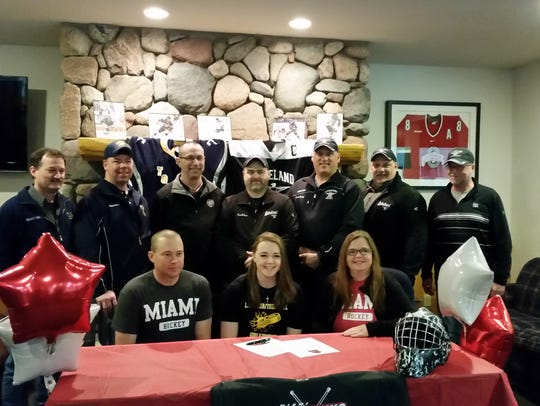 Erin Sparks, front center, signs her letter of intent