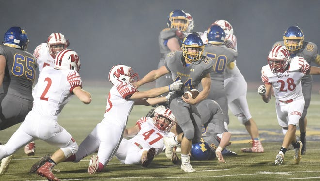 Maine-Endwell's Josh Chandler tries to shake a tackle during Friday night's Section 4 Football Conference Class B quarterfinal against visiting Waverly.