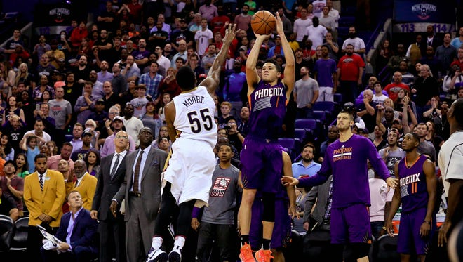 Phoenix Suns guard Devin Booker (1) shoots over New Orleans Pelicans guard E'Twaun Moore (55) as time expires in the fourth quarter sending the game to overtime at the Smoothie King Center. The Suns defeated the Pelicans 112-111 in overtime.