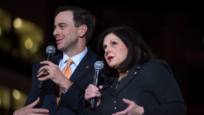 Former athletics director John Currie, left, and former chancellor Beverly Davenport speak on stage during a ceremony introducing Currie on March 2, 2017, in Thompson-Boling Arena.