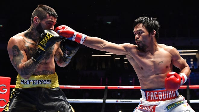 Manny Pacquiao (R) fights Lucas Matthysse during their world welterweight boxing championship bout.