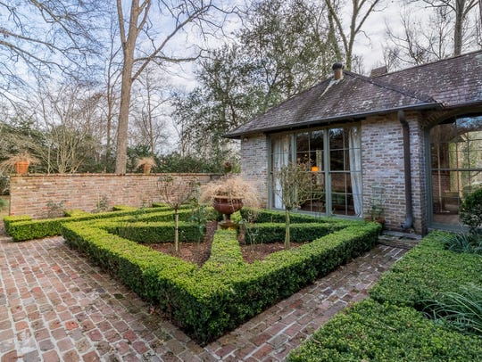 The home sits on more than an acre of beautifully landscaped