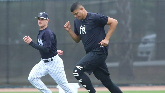 Pitcher Nick Rumbelow does a cardio workout with fellow pitcher Dellin Betances, who arrived at practice after losing a salary arbitration hearing.