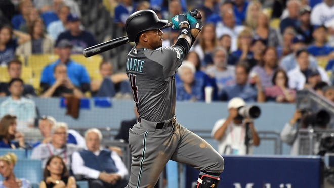 October 6, 2017; Los Angeles, CA, USA; Arizona Diamondbacks shortstop Ketel Marte (4) hits a solo home run in the seventh inning against the Los Angeles Dodgers in game one of the 2017 NLDS at Dodger Stadium. Mandatory Credit: Richard Mackson-USA TODAY Sports