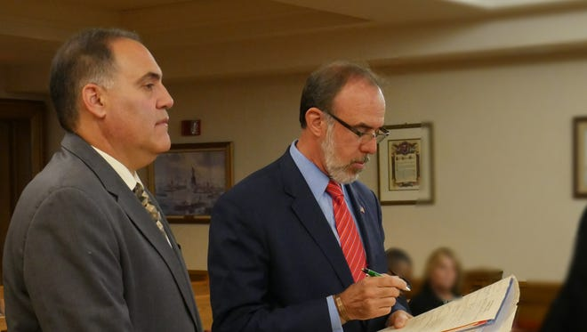 Steven Schwartz, left, stands next to his attorney Joseph Tock at his arraignment in Dutchess County Court on June 14, 2018.