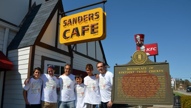 In this Saturday, April 4, 2015 photo, from left, Jason Lutfy, Sebastien Pitre, Neil Janna, Jesse Janna, Josh Janna and Brian Lutfy, from Montreal, pose for a photo outside the Harland Sanders Cafe and Museum in Corbin, Ky. The friends left Montreal on Thursday, traveling to Col. Sanders' birthplace and burial place before arriving at the Corbin restaurant Saturday afternoon. (AP Photo/The Times-Tribune, Jeff Noble)