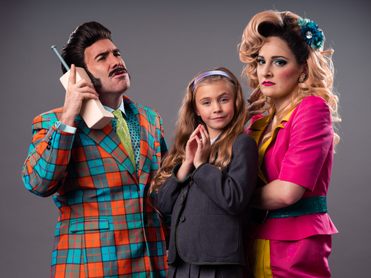 """Brad Bradley, from left, as Mr. Wormwood, Lydia Ricks as Matilda and Sara Gallo as Mrs. Wormwood in Tuacahn's production of """"Matilda the Musical"""""""