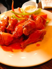 The Wings from Joe, Vinny & Bronson's Bohemian Café may be ordered in traditional spicy (shown) or lemon pepper sauce.