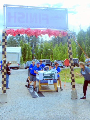 "The bed raced by Baudo Builds was first through the finish line in the Great High Mountain Bed Race to benefit a drop-in center for students experiencing homelessness. But the race winner based on actual time was Heber ""Freshboys"" Ramos."