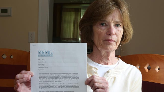 Joanne Wiley holds a letter June 3, 2015 telling her she was laid off from the Mount Kisco Medical Group, where she was employed for the past six years.