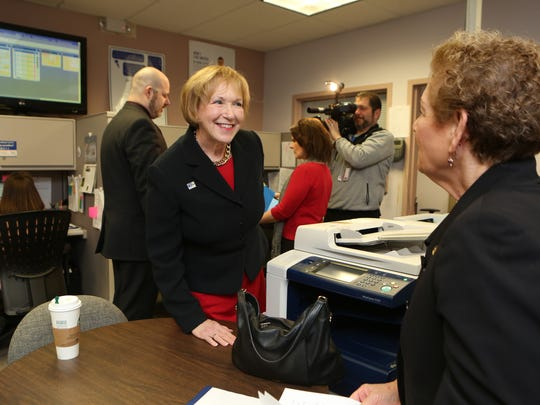 Alana Sweeny, the President and CEO of the United Way of Westchester and Putnam, greets Assemblywoman Ellen Jaffe in the United Way's 211 call center in White Plains, Feb. 21, 2017.