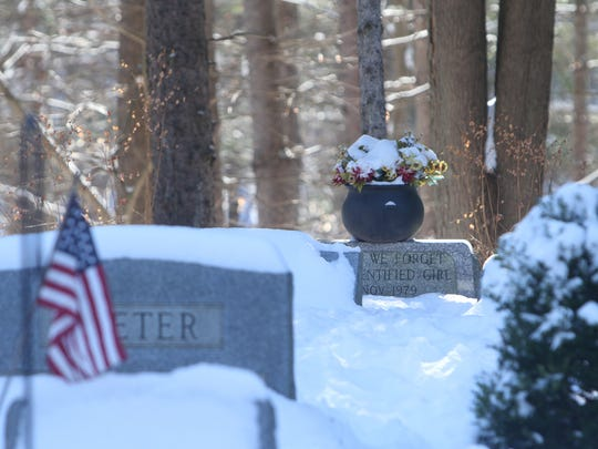 Tammy Jo Alexander's grave is located along a tree