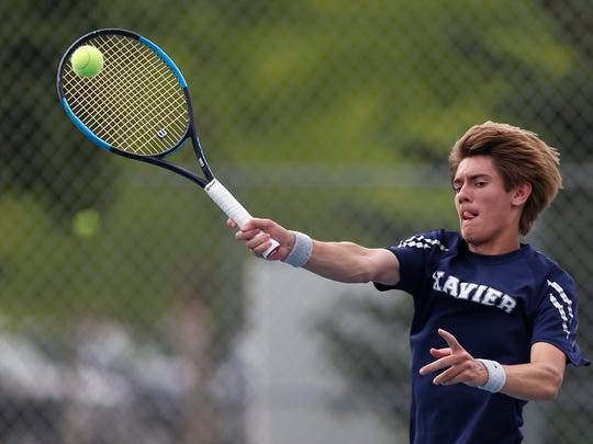 Cedar Rapids Xavier Jon Lansing returns a serve in a singles matchup against South Hardin's Cauy Teske at the Iowa High School Boys State Tennis Tournament at Byrnes Tennis Center Friday, May 25, 2018, in Waterloo, Iowa.