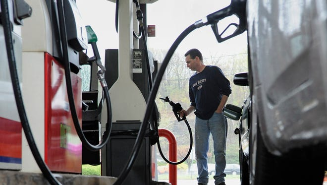 John Magel pumps gas at a station in Wethersfield, Conn., in this 2011 file photo